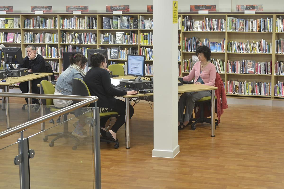 Library users working on computers
