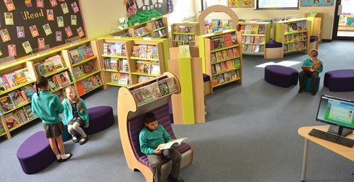 Children reading in primary school library