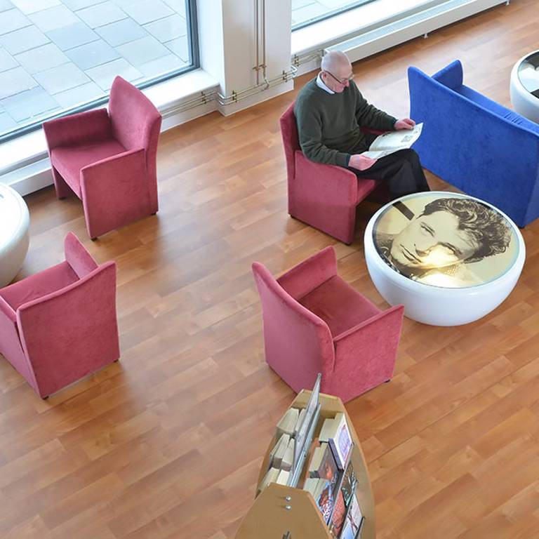 Movie-themed tables in ex-cinema turned library, Risca Palace Library