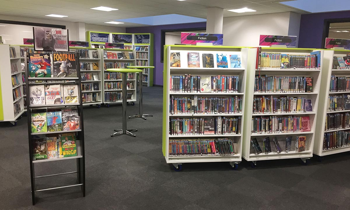 View from library entrance, bookcases and book pods