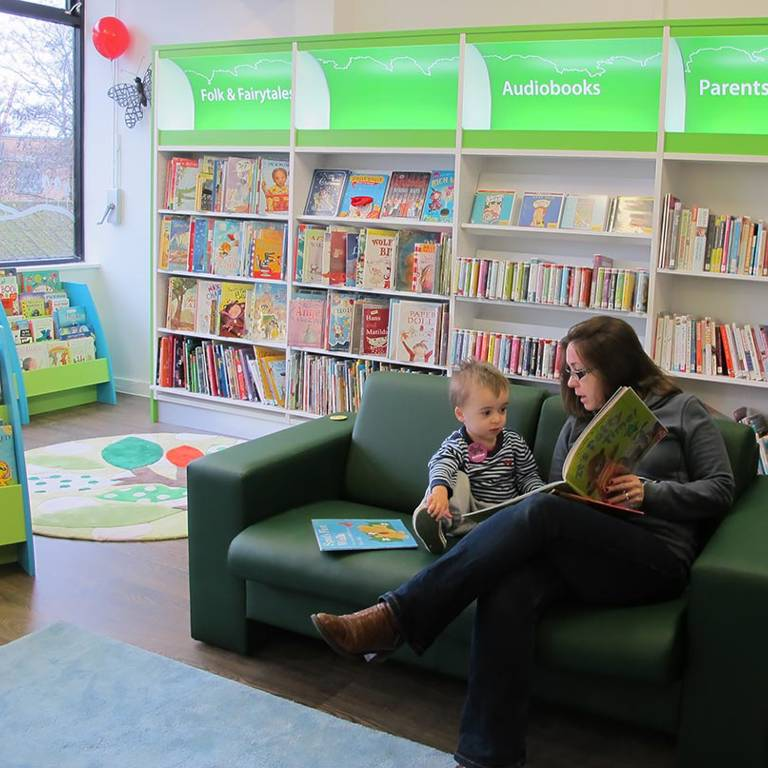 Sharing a book, South Woodford Library