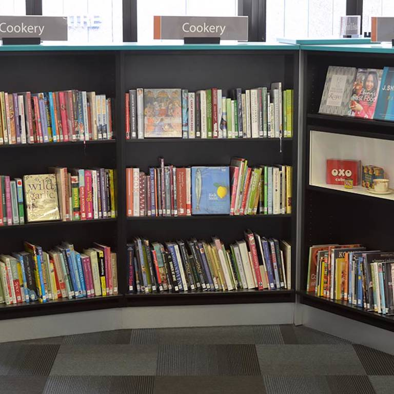 Museum case displays vintage cookery items, Redbridge Library