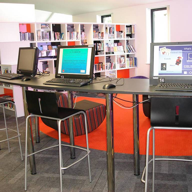 Bar-height IT desk and accent flooring define teens' area, Wellington Library