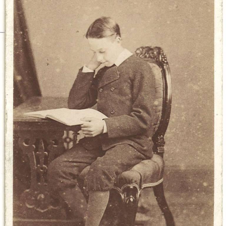 Teenage boy reading book