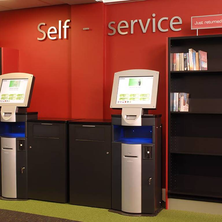 Self-service area highlighted with accent colour on walls and carpet, Yate Library
