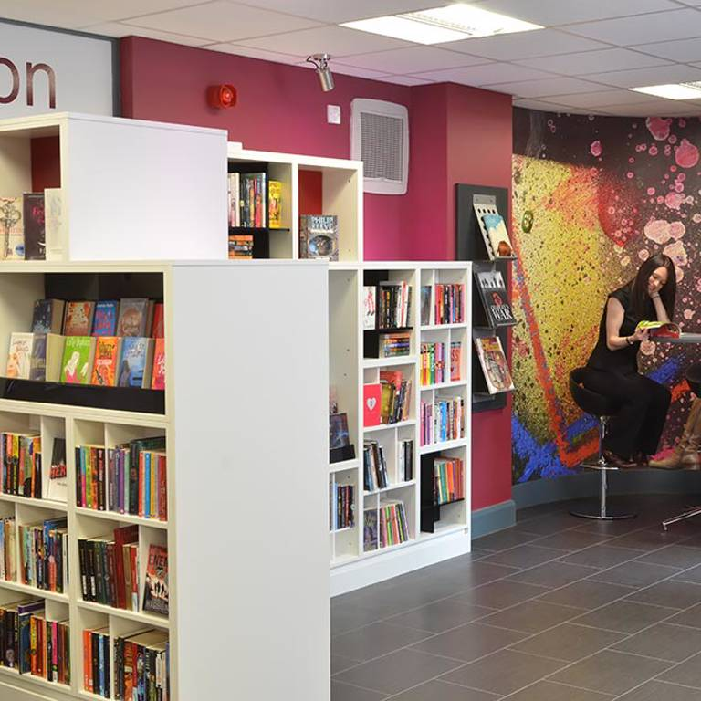 Graffiti wall graphic and cube shelving in teens' area, Gateshead Central Library