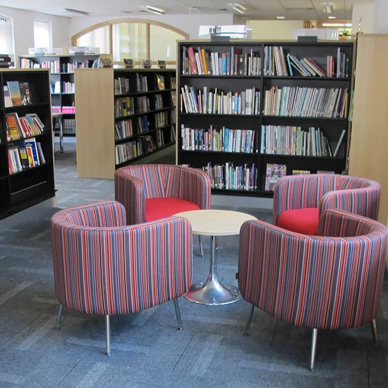 Inviting armchairs in the non-fiction area, Wellington Library