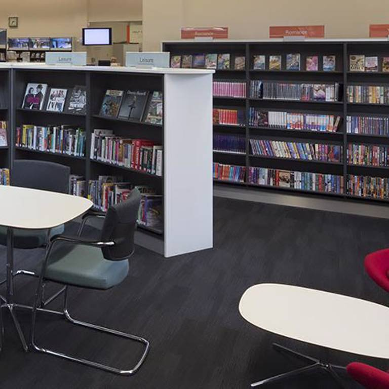 Desks and chairs in easy reach of books, West Bridgford Library
