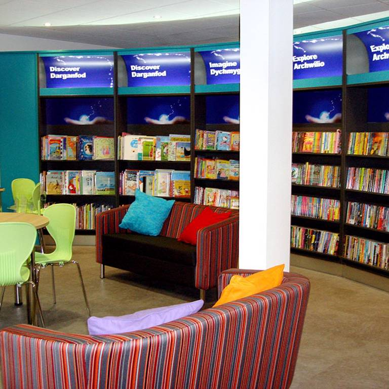 Colourful cushions on sofas in children's area, Bridgend Library